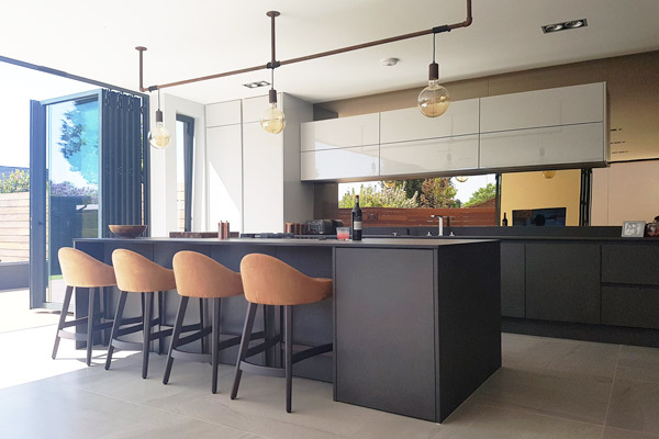 Handleless Dark Grey Concrete Kitchen in London.